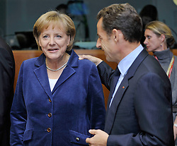 """Angela Merkel, Germany's chancellor, left, speaks with Nicolas Sarkozy, France's president, during the European Union Summit at the EU headquarters in Brussels, Belgium, on Thursday, Oct. 29, 2009. European Union leaders are set for """"very difficult"""" talks to overcome the Czech Republic's resistance to a new governing treaty designed to strengthen the EU's influence in world affairs, Reinfeldt said. (Photo © Jock Fistick)"""