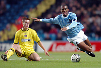 Photo. Matthew Lewis.<br /> Manchester City v Charlton Athletic. FA Barclycard Premiership. 07/01/2004.<br /> <br /> Manchester's Sylvain Distin is tackled by Charlton's Scott Parker.