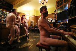 NOTE NUDITY Pianist Luke Meredith (right) with Davidos Pass, Maria Beadell and Emma Ruth taking part in London's first nudist pub singalong at the Coach And Horses in Soho.