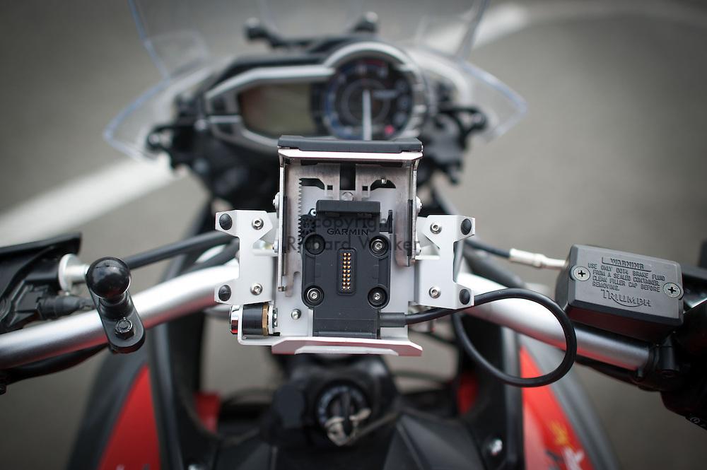 2013 May 07 - Touratech Zumo 660/665 Handlebar Mount V2.0, locking, Silver. Mounted to a Triumph Tiger 800 XC motorcycle. Seattle, WA. By Richard Walker