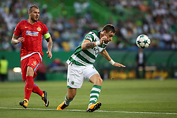 August 15, 2017 - Lisbon, Portugal - Sporting's defender Sebastian Coates from Uruguay (R ) vies with Steaua's forward Denis Alibec during the UEFA Champions League play-offs first leg football match between Sporting CP and FC Steaua Bucuresti at the Alvalade stadium in Lisbon, Portugal on August 15, 2017. Photo: Pedro Fiuza (Credit Image: © Pedro Fiuza via ZUMA Wire)