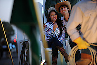 King and queen of the Castroville Artcihoke Festival ride on their decorated float at the 2013 Colmo del Rodeo Parade Saturday evening in Salinas.