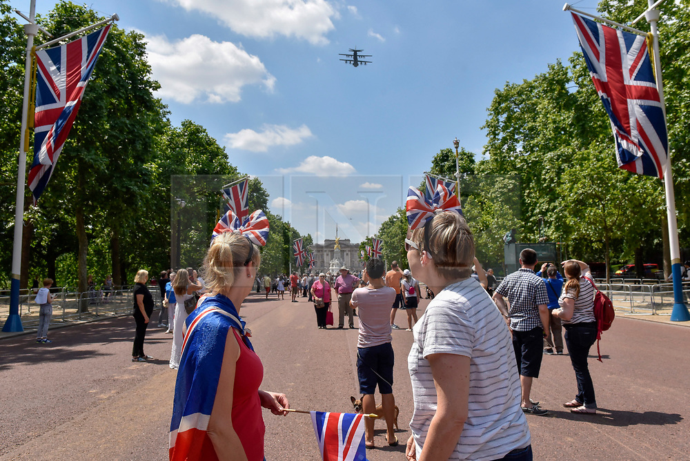 © Licensed to London News Pictures. 17/06/2017. London, UK. Large crowds gather in The Mall to watch the annual aerial fly past which takes place after the Trooping of the Colour. Photo credit : Stephen Chung/LNP