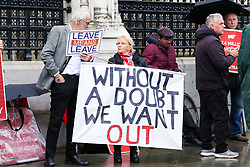 © Licensed to London News Pictures. 21/10/2019. London, UK. Pro-Brexit supporters with placards outside The Houses of Parliament in Westminster. Photo credit: Dinendra Haria/LNP