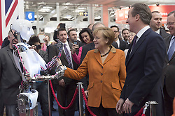 61192673<br /> In the picture  - Chancellor Angela Merkel and Federal Chairman of the CDU left and David Cameron Prime Minister welcome a fully automated Robots ger Bus during CeBit 2014, CeBIT 2014 Technology Trade Fair, n Hanover, Germany, Monday, 10th March 2014. Picture by  imago / i-Images<br /> UK ONLY