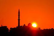 Israel, Coastal Plains, Jisr Az-Zarqa Silhouette of the Mosque at sunrise