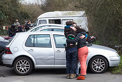 Sipson, UK. 8th March, 2021. A group of three former residents of a squatted off-grid eco-community garden known as Grow Heathrow embrace after being evicted by bailiffs from the National Eviction Team (NET), facilitated by the Metropolitan Police. Grow Heathrow was founded in 2010 on a previously derelict site close to Heathrow airport in protest against government plans for a third runway and has since made a significant educational and spiritual contribution to life in the Heathrow villages which are threatened by airport expansion.