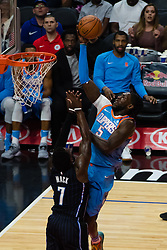 March 10, 2018 - Los Angeles, CA, U.S. - LOS ANGELES, CA - MARCH 10: LA Clippers forward Montrezl Harrell (5) drives the ball into the basket against Orlando Magic guard Shelvin Mack (7) during the game between the Orlando Magic and the LA Clippers on March 10, 2018, at STAPLES Center in Los Angeles, CA. (Photo by David Dennis/Icon Sportswire) (Credit Image: © David Dennis/Icon SMI via ZUMA Press)