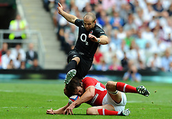 Photo © SPORTZPICS / SECONDS LEFT IMAGES 2011 - Rugby Union - Investic - World Cup warm up game - England V Wales - 06/08/11 - England's Charlie Sharples has his kick ahead stopped by Wales' Ryan Jones - at Twickenham Stadium UK - All rights reserved