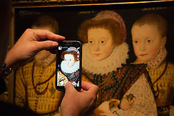 "© Licensed to London News Pictures. 09/10/2013. London, England. Pictured: Three Unknown Elizabethan Children"" on a mobile phone display. Press preview of the exhibition ""Elizabeth I & Her People"" at the National Portrait Gallery which explores the remarkable reign of Elizabeth I through the lives and portraiture of her subjects. Exhibition runs from 10 October 2013 to 5 January 2014. Photo credit: Bettina Strenske/LNP"