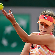 PARIS, FRANCE October 01. Sofia Kenin of the United States performs her no look service toss while serving against Ana Bogdan of Romania in the second round of the singles competition on Court Philippe-Chatrier during the French Open Tennis Tournament at Roland Garros on October 1st 2020 in Paris, France. (Photo by Tim Clayton/Corbis via Getty Images)