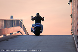 Arlen rides up the ramp to the second story of his new store. Dublin, CA. 2003. Photography ©2004 Michael Lichter.