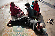 A family struggles to survive living at the train station in Jaipur, India.  Children, some who have run away from their families, find themselves living homeless on the train tracks waititng for the next train to arrive at the train station in Jaipur, India.  Once the train arrives they raid the train looking for plastic bottles that they can then sell.  Most will make about $1.50/day but spend most of it on glue which they are most addicted to.