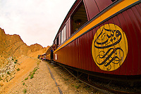 Red Lizard (Lezard Rouge) train passes through Selja Gorge, Tunisia