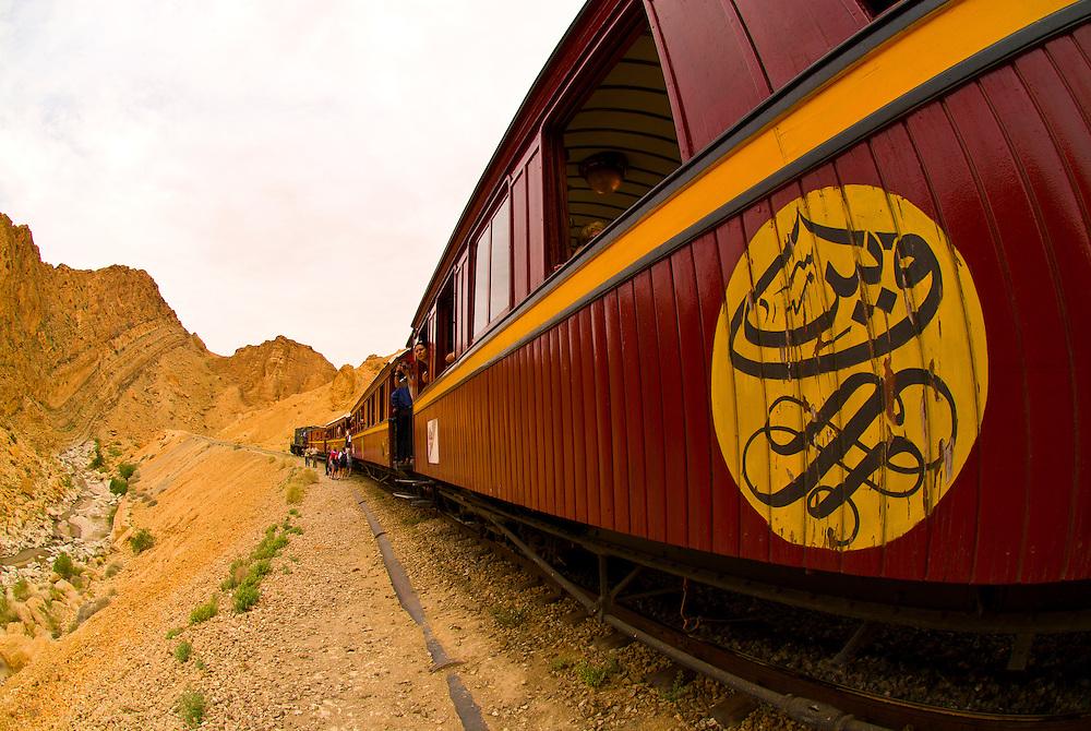 Red Lizard (Lezard Rouge) train passes through Selja Gorge, Tunisia