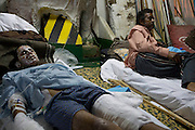 Mcc0030300 . Daily Telegraph..Severely injured survivors from the besieged town of Miserata onboard a Turkish hospital ship at Benghazi port before leaving for Turkey...Benghazi 3 April 2011