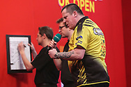 Dave Chisnall hits a double and celebrates during the Ladbrokes UK Open Darts 2021 at stadium:mk, Milton Keynes, England. UK on 7 March 2021.