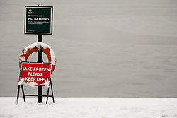 © Licensed to London News Pictures. 05/02/2012. LONDON, UK. A sign warning visitors to stay off the ice is seen at the Serpentine Lake in Hyde Park, London today (05/02/12). Millions of Britons woke up to a snowy Sunday after heavy snow fall covered much of the UK. Photo credit: Matt Cetti-Roberts/LNP