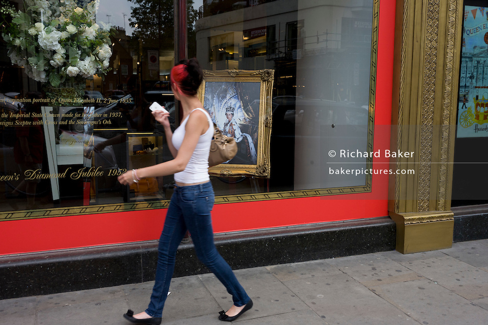 Londoners pass the classic portrait of Queen Elizabeth by Cecil Beaton positioned in the window of Harrods department store, Knightsbridge in the week of her diamond Jubilee celebrations.
