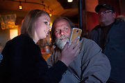 Andy Breland and his daughter, Sydney Paine, checking response on social media on her phone during the premier screening party of Dead End Express on National Geographic Television.