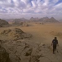 David Roberts hikes an ancient Bedouin route on Jebel [Mount] Burdah, in Jordan's Wadi Rum. (MR)