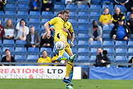 Oxford United striker Jamie Mackie (19) battles for possession during the EFL Sky Bet League 1 match between Oxford United and Coventry City at the Kassam Stadium, Oxford, England on 9 September 2018.