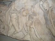 Large podium frieze.  Warriors in combat, either on foot or on horseback.