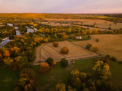 The setting sun's rays illuminate the lush English landscape at Hurley near Maidenhead, Berkshire, as the colours of autumn begin to appear on the trees. Hurley, October 01 2018.