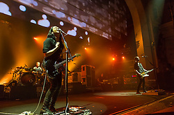 © Licensed to London News Pictures. 16/12/2013. London, UK.   Placebo performing live at Brixton Academy. In this picture - Steve Forrest (left), Brian Molko (centre), Stefan Olsdal (right).  .Placebo are an English alternative rock band, formed in London in 1994, consisting of members Brian Molko (lead vocals/guitars), Stefan Olsdal (vocals/bass), Steve Forrest (drums/vocals).  The band is touring to support its seventh studio album 'Loud Like Love'. Photo credit : Richard Isaac/LNP