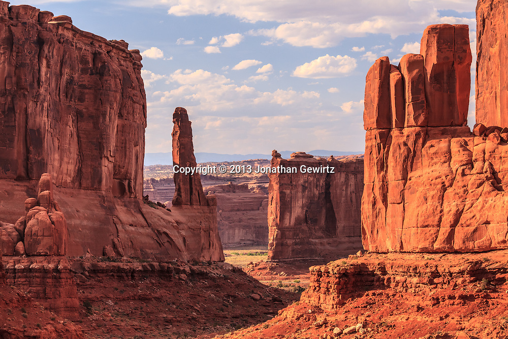 Dramatic rock formations along the Park Avenue trail in Arches National Park, Utah. WATERMARKS WILL NOT APPEAR ON PRINTS OR LICENSED IMAGES.<br /> <br /> Licensing: https://tandemstock.com/assets/72685729