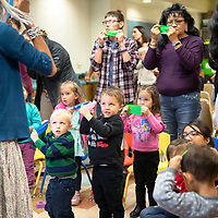 Radmilla Cody leads the crowd during Ats'is, the body song, Wednesday, Nov. 13 at the Octavia Fellin Public Library Children's Branch during Shimá Storytelling.