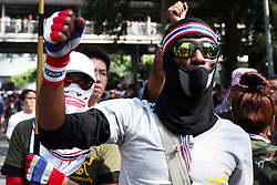 © Licensed to London News Pictures. 18/01/2014. Anti-Government protestors enter the Royal Thai Police Head quarters in response to an explosive device reportedly injuring as many as 30 people and killing one yesterday during an anti-government street rally in Bangkok, Thailand. Anti-government protesters launch 'Bangkok Shutdown', blocking major intersections in the heart of the capital, as part of their bid to oust the government of Prime Minister Yingluck Shinawatra ahead of elections scheduled to take place on February 2. Photo credit : Asanka Brendon Ratnayake/LNP
