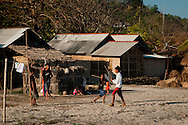 Indonesia, Lombok. Stick fighting is a very popular on Lombok, played widely especially in Kotaraja region. On the picture: boys stickfighting on a beach in Kuta.