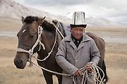 Torsun, a yak herder near Chatyr Köl, Naryn province of Kyrgyzstan