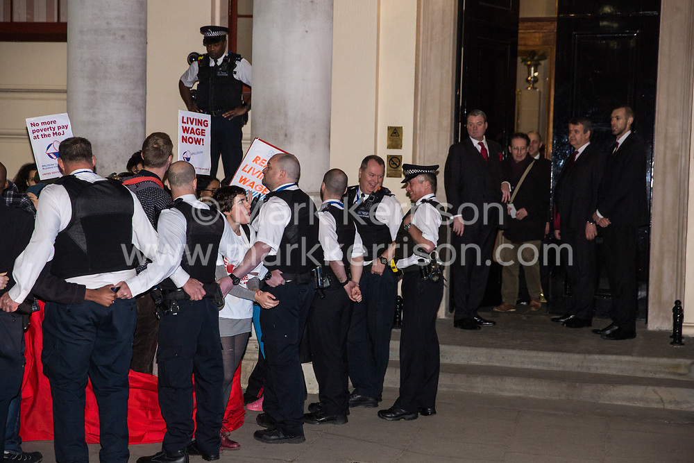 London, UK. 12th February, 2019. Police officers contain members and supporters of grassroots trade union United Voices of the World protesting outside the Gadson Club in Pall Mall on the occasion of a reception with Justice Secretary David Gauke against his refusal to negotiate with the trade union over their demands for the London Living Wage, annual leave and sick pay for outsourced cleaners, security guards and receptionists working at the Ministry of Justice, all of whom have been on strike for varying periods recently. The Gadson Club is the official alumni club for the Oxford University Conservative Association.