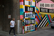 Be bad until you're good and good until you're great street art in Shoreditch, East London, United Kingdom. Street art in the East End of London is an ever changing visual enigma, as the artworks constantly change, as councils clean some walls or new works go up in place of others. While some consider this vandalism or graffiti, these artworks are very popular among local people and visitors alike, as a sense of poignancy remains in the work, many of which have subtle messages. (photo by Mike Kemp/In Pictures via Getty Images)