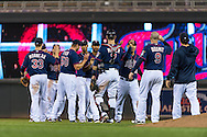 The Minnesota Twins celebrate after defeating the Chicago White Sox on May 13, 2013 at Target Field in Minneapolis, Minnesota.  The Twins defeated the White Sox 10 to 3.  Photo: Ben Krause