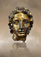 Roman bust of Alexander the Great, 2nd cent B.C bronze with gold leaf. The head is from a smaller than life size statue. The elongated curls, the parted locks and the diadem that fastens the hair at the back, are clear indications that the head is a portrait of the Macedonian King Alexander the Great (356-323 B.C.). Inv 66177, The National Roman Museum, Rome, Italy .<br /> <br /> If you prefer to buy from our ALAMY PHOTO LIBRARY  Collection visit : https://www.alamy.com/portfolio/paul-williams-funkystock/roman-museum-rome-sculpture.html<br /> <br /> Visit our ROMAN ART & HISTORIC SITES PHOTO COLLECTIONS for more photos to download or buy as wall art prints https://funkystock.photoshelter.com/gallery-collection/The-Romans-Art-Artefacts-Antiquities-Historic-Sites-Pictures-Images/C0000r2uLJJo9_s0