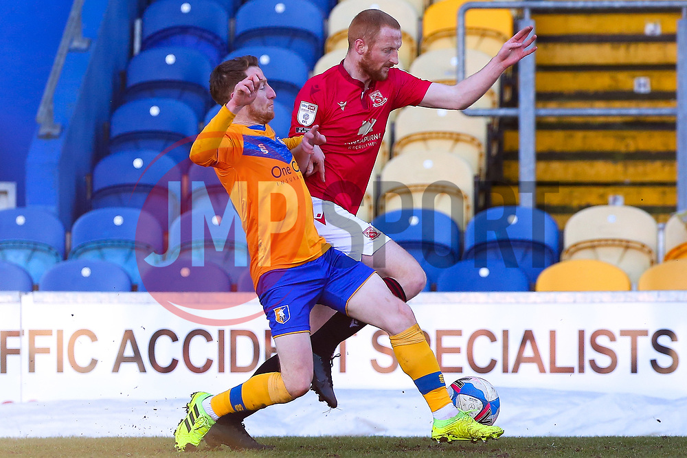 Stephen Quinn of Mansfield Town challenges Liam Gibson of Morecambe for possession - Mandatory by-line: Ryan Crockett/JMP - 27/02/2021 - FOOTBALL - One Call Stadium - Mansfield, England - Mansfield Town v Morecambe - Sky Bet League Two