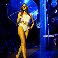 Model presents a swimsuite on the catwalk during Cosmopolitan Bikini Show the magazine's annual summer event.