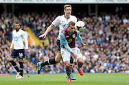 Aston Villa's Andreas Weimann and Tottenham Hotspur's Michael Dawson competing for the ball . Barclays premier league match ,Tottenham Hotspur v Aston Villa at White Hart Lane in Tottenham, London  on Sunday 11th May 2014.<br /> pic by John Patrick Fletcher, Andrew Orchard sports photography.