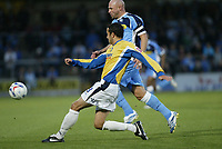 Photo: Marc Atkins.<br /> Wycombe Wanderers v Mansfield Town. Coca Cola League 2. 01/09/2006. Gareth Jelleyman (F) shrugs of Tommy Mooney of Wycombe.