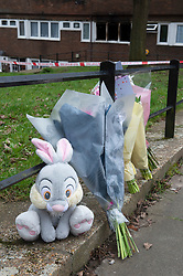 © Licensed to London News Pictures 07/03/2021. Greenwich, UK. Flowers at the scene. Police and London Fire Brigade forensic teams continue to work at the scene of a fatal fire that killed a five year old boy and has left the rest of his family in hospital. The property in Greenwich, South East London is still cordoned off today with flowers and balloons being placed at the scene. Photo credit:Grant Falvey/LNP