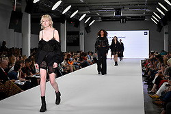© Licensed to London News Pictures. 03/06/2018. LONDON, UK. Models present looks by Rebecca Armstrong from Glasgow School of Art on the opening day of Graduate Fashion Week taking place at the Old Truman Brewery in East London.  The event presents the graduation show of up and coming fashion designers from UK and international universities.  Photo credit: Stephen Chung/LNP