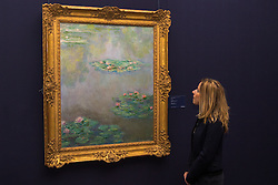 "Sotheby's, Mayfair, London, October 9th 2015. Ahead of its auction in New York, Sotheby's displays Claude Monet's iconic impressionist lily pond painting ""Nympheas"", painted in the artist's garden at Giverny in 1908. The painting is expected to fetch between $30 and 50 million when it goes under the hammer later this year in New York. PICTURED:  // Contact: paul@pauldaveycreative.co.uk Mobile 07966 016 296"