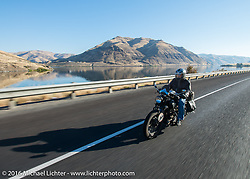 Dennis Leggett riding his 1936 Indian Sport Scout along the Snake River leaving Lewiston during Stage 15 (244 miles) of the Motorcycle Cannonball Cross-Country Endurance Run, which on this day ran from Lewiston, Idaho to Yakima, WA, USA. Saturday, September 20, 2014.  Photography ©2014 Michael Lichter.