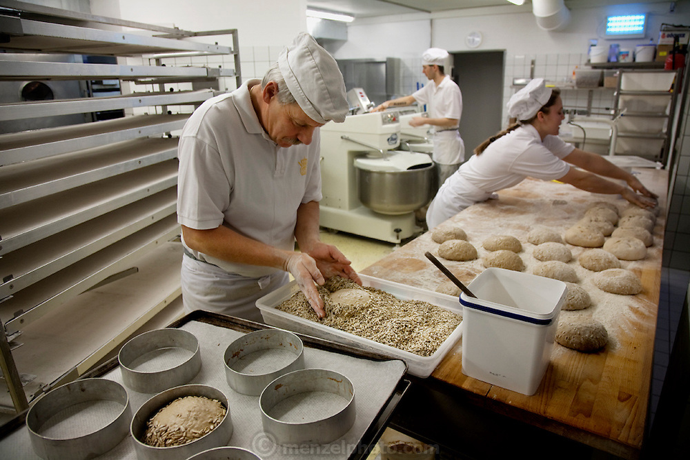 Robina Weiser-Linnartz (right), a master baker and confectioner at work as a baker and pastry chef at Bastians Restaurant and bakery in Cologne, Germany. (From the book What I Eat: Around the World in 80 Diets.) The caloric value of her day's worth of food in March was 3700 kcals. She is 28 years of age; 5 feet, 6 inches and 144 pounds.
