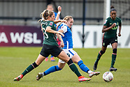 Shelina Zadorsky of Tottenham Hotspur Women and Claudia Walker of Birmingham City Women battles for possession during the FA Women's Super League match between BIrmingham City Women and Tottenham Hotspur Women at Solihull Moors FC, Solihull, United Kingdom on 9 May 2021.