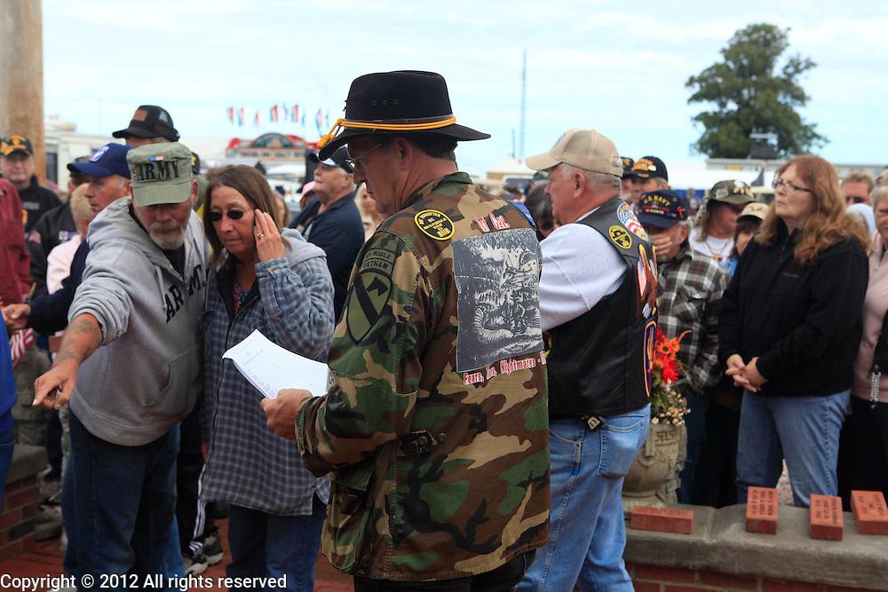 Kokomo Indiana Vietnam Veterans Reunion 2012 placing memorial bricks near flag for the dead