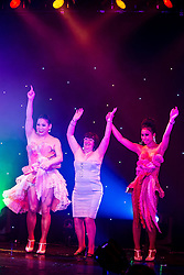 """© Licensed to London News Pictures . 26/06/2013 . Manchester , UK . Shameless actress Alice Barry (centre) dances to YMCA on stage with the Ladyboys . The Ladyboys of Bangkok perform their show , """" Glamorous Amorous """" at the Sabai Pavilion , in Manchester , as part of their 2013 UK tour . Photo credit : Joel Goodman/LNP"""